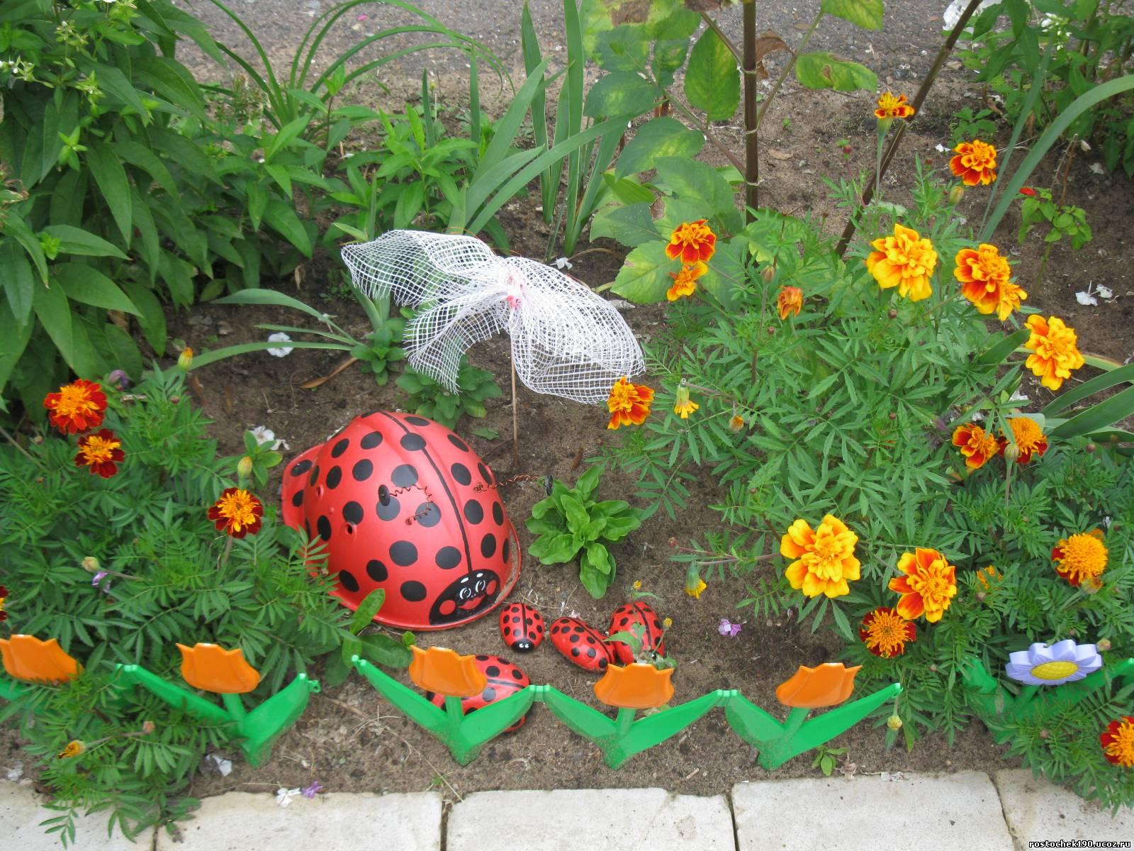 Поделки на цветочной клумбе фото